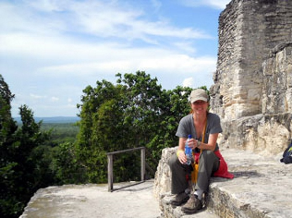 A woman at the top of the Temple 4 in Tikal